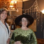 Off the shelf poetry event at Grimm & Co, with one artist dressed as a scientist, and one wearing a witches hat.