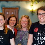 Staff after delivering radio writing workshop, wearing Grimm & Co T-shirts
