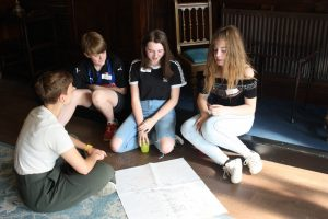 Group of young people discussing a piece of work