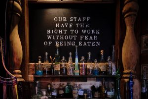 "Sign saying ""Our staff have the right to work without fear of being eaten"""