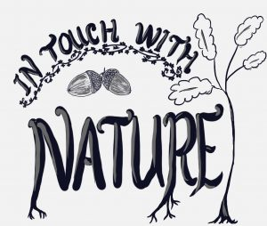 """Illustrated wording saying """"In touch with nature"""", with acorns and a tree."""