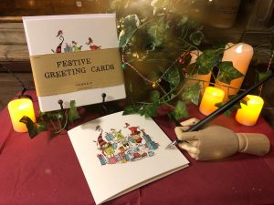 Christmas cards with greenery and candles