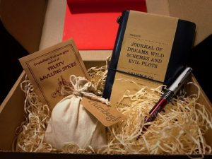 Gift box for an adult, containing humbugs, journal and pen