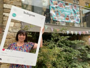 Operations Manager, Lisa Holden, holding a selfie frame at the Scriba PR party